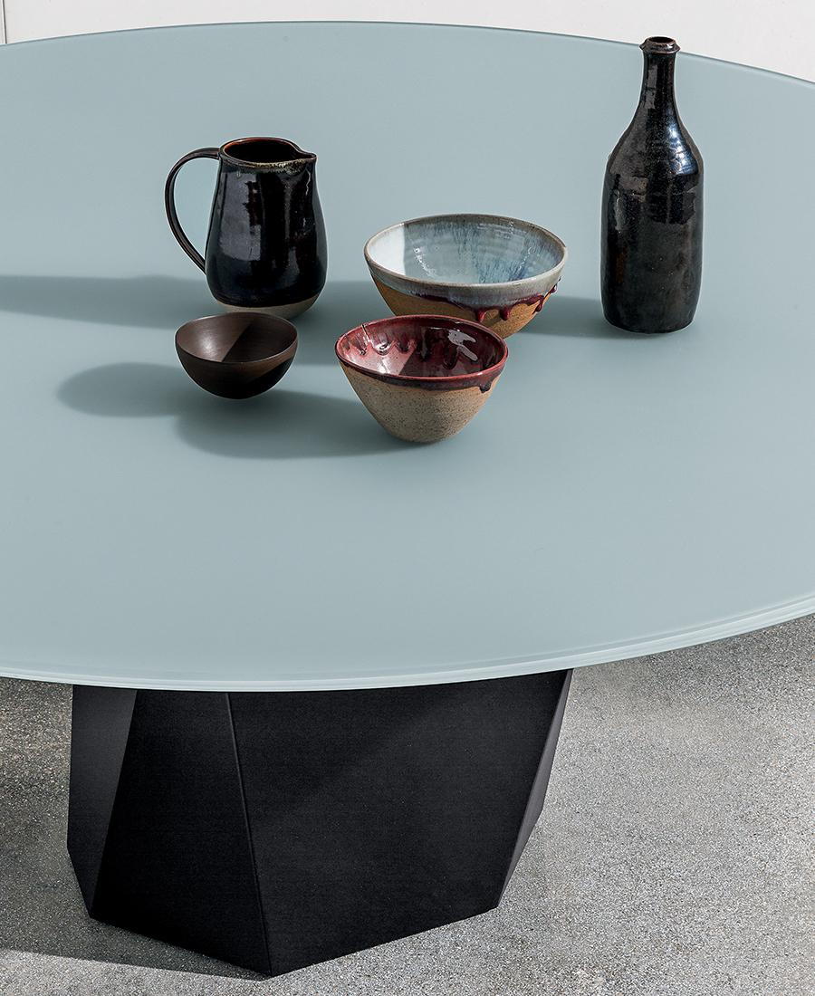 Deod dining table detail with black metal base and top in frosted glass lacquered cement